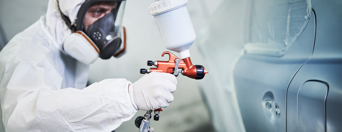 Technician spraying and repairing a vehicle - Body and Paint Repairs Worksop